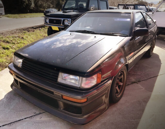 FRONT EXTERIOR OF AE86 LEVIN GTV BROWN METALLIC.
