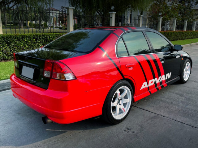 REAR EXTERIOR OF ES CIVIC 4-DOOR to ADVAN RACING.