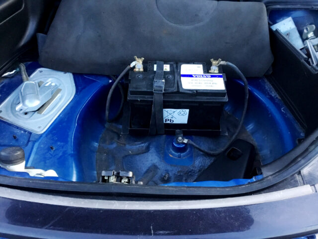 BATTERY RELOCATION TO LUGGAGE SPACE.