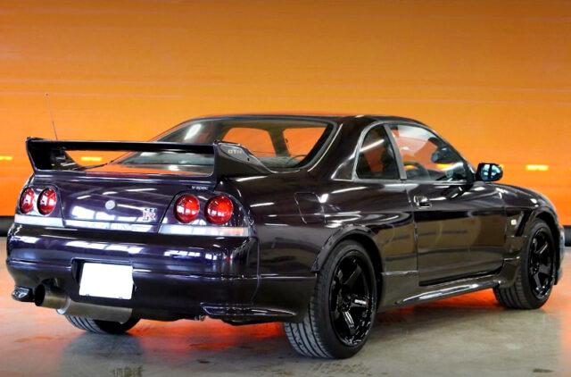REAR EXTERIOR OF R33 GT-R V-SPEC MIDNIGHT PURPLE.