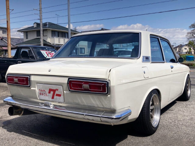 REAR EXTERIOR OF 510 BLUEBIRD 2-DOOR SEDAN.