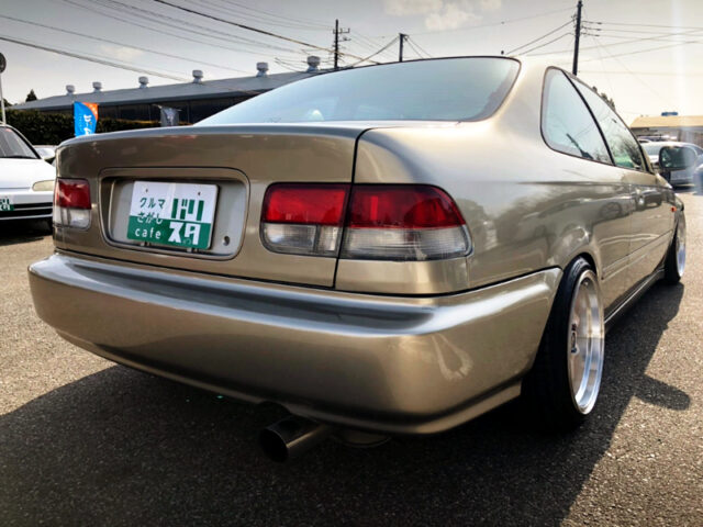 REAR EXTERIOR OF EJ7 CIVIC COUPE with GOLD PAINT.