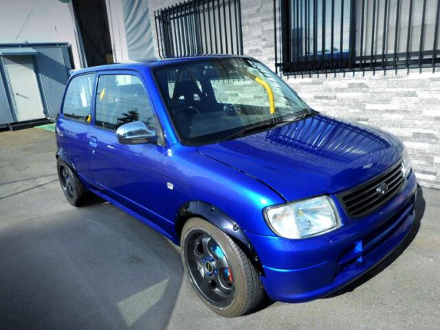 FRONT EXTERIOR OF L700S MIRA 3-DOOR BLUE METALLIC.