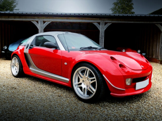 FRONT EXTERIOR OF SMART ROADSTER COUPE with FERRARI RED.
