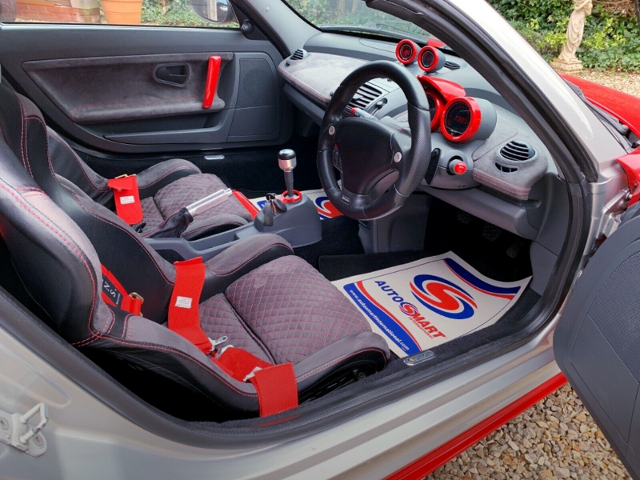 INTERIOR OF SMART ROADSTER COUPE with FERRARI RED.