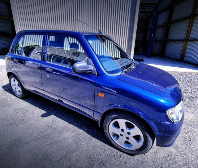 FRONT SIDE EXTERIOR OF L700 MIRA 5-DOOR BLUE.