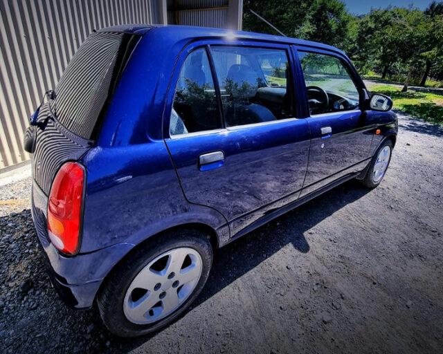 REAR SIDE EXTERIOR OF L700 MIRA 5-DOOR BLUE.