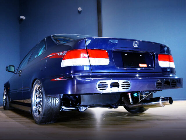 REAR EXTERIOR OF EJ7 CIVIC COUPE.