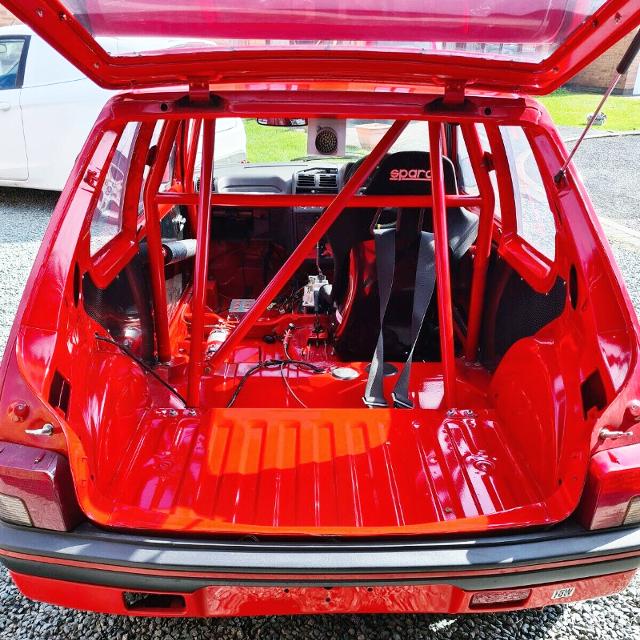 REAR HATCH OPENED PEUGEOT 205 GTI.