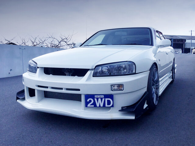 FRONT EXTERIOR OF R34 4-DOOR with White.