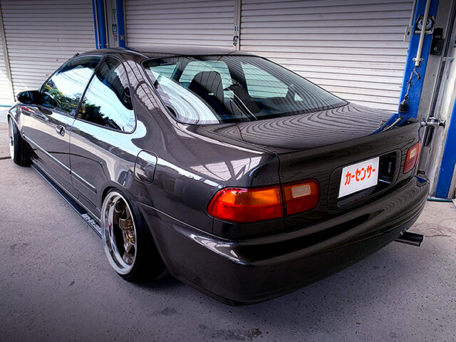 REAR EXTERIOR OF EJ1 CIVIC COUPE BROWN.