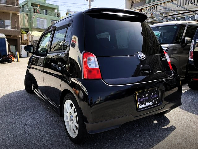 REAR EXTERIOR OF DAIHATSU ESSE BLACK.