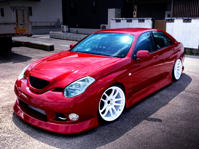 FRONT EXTERIOR OF JZX110 VEROSSA with RED METTALIC.