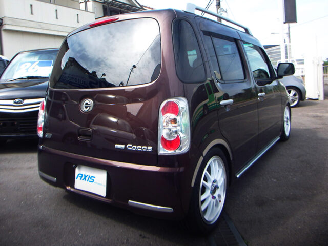 REAR EXTERIOR OF L675S MIRA COCOA BROWN.