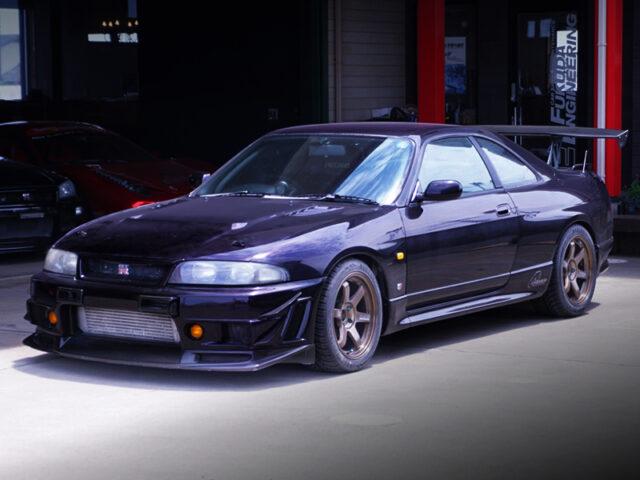 FRONT EXTERIOR OF R33 GT-R V-SPEC MIDNIGHT PURPLE.