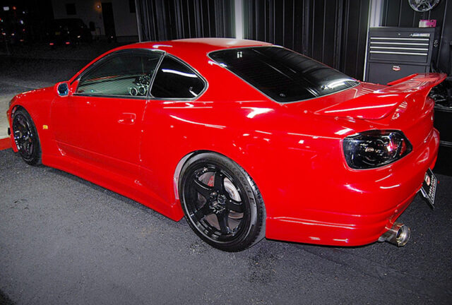 REAR LEFT-SIDE EXTERIOR OF S15 SILVIA SPEC-R of RED COLOR.
