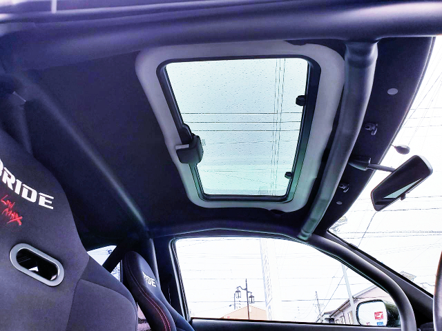 AFTERMARKET SUNROOF INSTALLED.