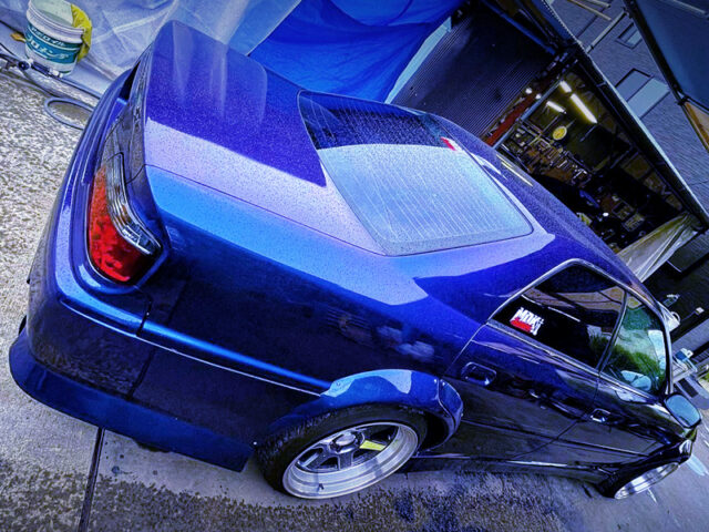 REAR RIGHT-SIDE EXTERIOR OF JZX100 CHASER WIDEBODY.