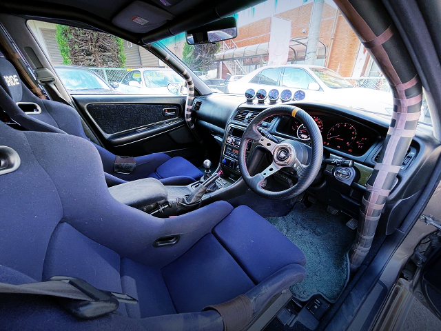 DRIVER'S DASHBOARD and ROLL CAGE.