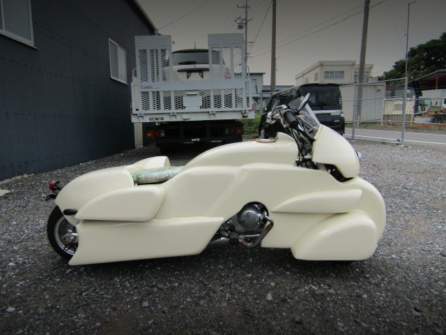 LEFT-SIDE EXTERIOR OF MONKEY WITH SIDECAR.