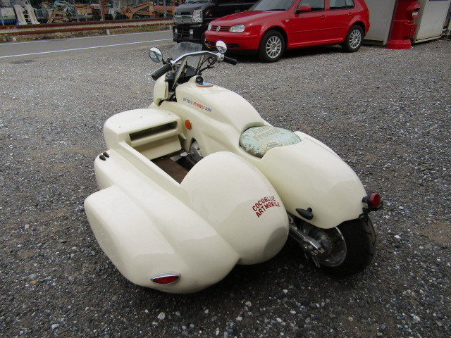 REAR EXTERIOR OF MONKEY WITH SIDECAR.