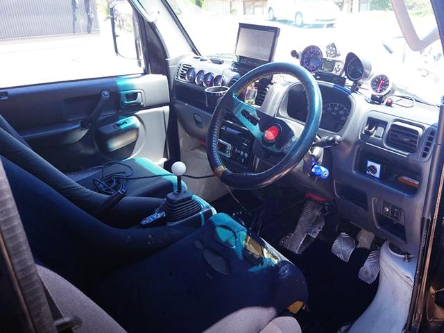 DRIVER'S INTERIOR OF DA63T CARRY TRUCK.