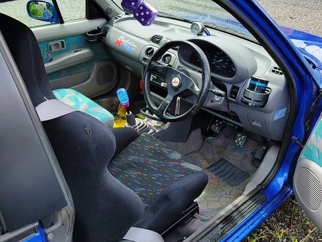 DRIVER'S INTERIOR OF K11 NISSAN MARCH CABRIOLET.