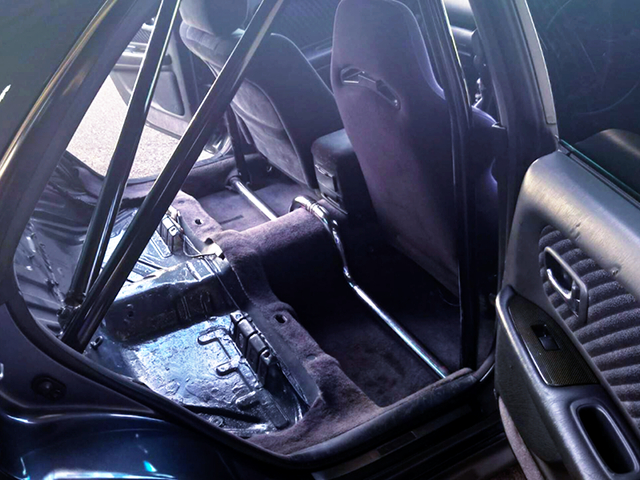 BACKSEAT DELETE and ROLL CAGE INSTALLED.
