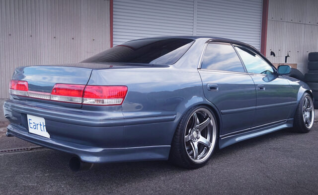 REAR EXTERIOR OF JZX100 MARK 2 TOURER-V with SUBARU COOL GRAY PAINT.
