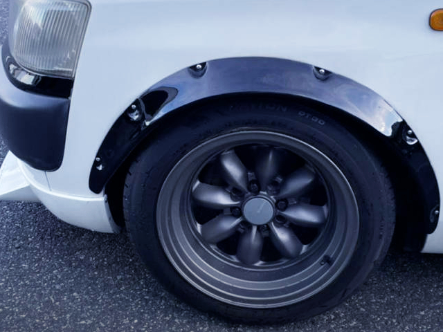 FRONT FENDER FLARE and EIGHT SPOKE WHEEL.