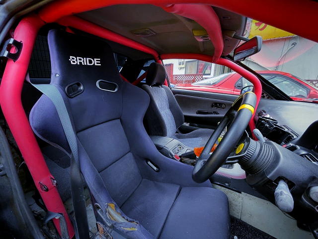 ROLL CAGE and DRIVER'S BRIDE FULL BUCKET SEAT.