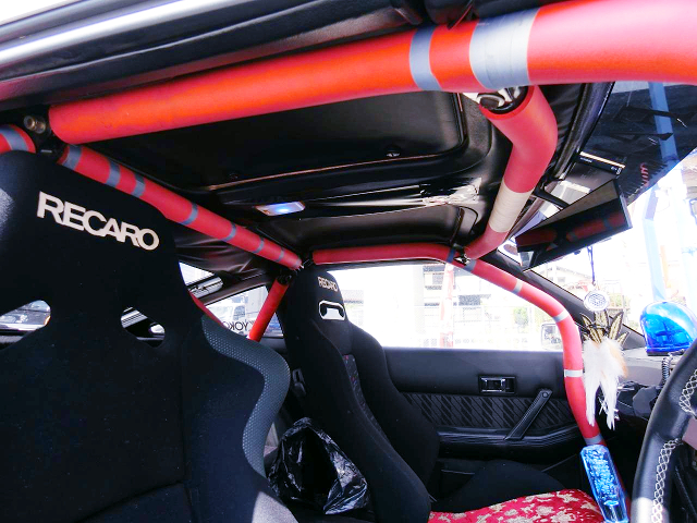 ROLL CAGE and RECARO SEATS.
